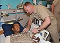US Navy 100709-N-8361C-005 Senior Chief Corpsman Woodie J. Wunstell pins the Fleet Marine Force Warfare Insignia on Hospital Corpsman Seaman Angelo Anderson.jpg