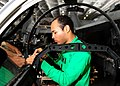US Navy 100816-N-3327M-047 Aviation Electrician's Mate Airman Hugh Ratsch, from Montegomery, Ala., installs the electrical harnesses.jpg