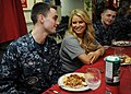 US Navy 101001-N-6427M-201 Information Systems Technician Seaman Todd Sines speaks with singer-actress Jessica Simpson on the mess decks during a U.jpg