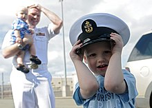 US Navy 110310-N-DX615-069 The son of Chief Information Systems Technician Jess Eisele wears his father's cover during a celebration for the arriva.jpg