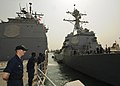 US Navy 110701-N-YM590-017 Sailors man the rails as the guided-missile cruiser USS Anzio (CG 68) departs Djibouti.jpg