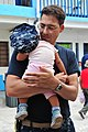US Navy 110706-F-NJ219-171 Lt. Cmdr. Jason Layton, a nurse from Wexford, Penn., holds a baby during a Continuing Promise 2011 medical community ser.jpg