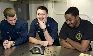 US Navy 111219-N-VO377-042 Sailors talk to New Orleans Saints tight-end Jimmy Graham during a holiday morale phone call aboard the Nimitz-Class air.jpg