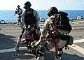 US Navy 111228-N-ED900-039 Members of the visit, board, search and seizure team aboard the guided-missile destroyer USS Pinckney (DDG 91) carry a S.jpg