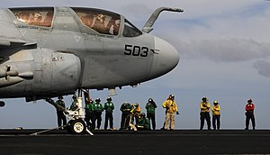 US Navy 120105-N-RG587-296 Sailors prepare an EA-6B Prowler assigned to Electronic Attack Squadron (VAQ) 134, for launch on the flight deck of the.jpg