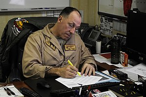 US Navy 120122-N-RG587-021 Capt. Rick LaBranche, commander of Carrier Air Wing (CVW) 17, reviews documents in his office aboard the Nimitz-class ai.jpg