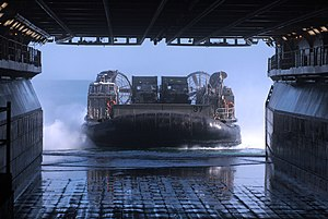 US Navy 120131-N-GF386-065 A landing craft air cushion from Assault Craft Unit (ACU) 4 approaches the welldeck of the amphibious assault ship USS K.jpg