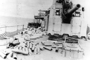 USS Hobson (DD-464) - Expended cartridge cases and powder tanks from the ship's 5-inch/38 caliber guns litter the deck, after firing in support of the Normandy invasion off Utah Beach, 6 June 1944. This view was taken on the ship's afterdeck, with mount 54 at right.