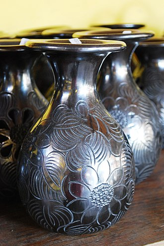 San Bartolo Coyotepec - Barro negro pottery in the metallic finish at the Doña Rosa Workshop
