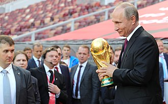 2018 FIFA World Cup - President Vladimir Putin holding the FIFA World Cup Trophy at a pre-tournament ceremony in Moscow on 9 September 2017