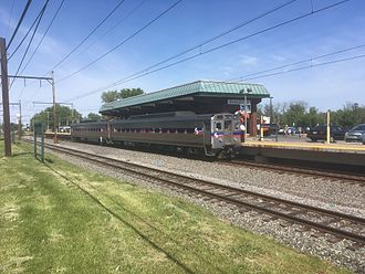 Warminster station (SEPTA) - An outbound train arrives at Warminster station in May 2017
