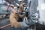 Washing an MH-60S Sea Hawk helicopter 130908-N-ZG705-236.jpg