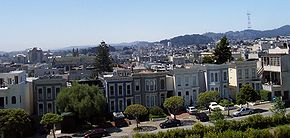 A southern view from Alta Plaza Park, which is in the Pacific Heights neighborhood. Most of the valley in the central part of this image is in the Western Addition neighborhood. In the background on the right can be seen Sutro Tower, which is west of Twin Peaks. The darker hill to the left and slightly more in the foreground is Buena Vista Heights, which is directly south of Haight Street (between the Haight-Fillmore and Haight-Ashbury neighborhoods). Cathedral Hill is visible to the left, just west of Van Ness Avenue and north of Hayes Valley.