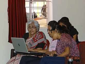 Street-level bureaucracy - A social worker in India teaches her clients how to use a laptop. As an exercise, she is showing them how to edit the Wikipedia online encyclopedia.