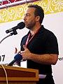 Wikimania2007 Jimbo hands at chest.jpg