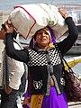 Woman Bears Load - Along Ghats - Varanasi - Uttar Pradesh - India (12498546015).jpg