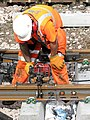 Work on the railway line - fitting a fishplate - geograph.org.uk - 1754305.jpg