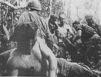 Wounded American soldiers being moved to aid station (Battle of Dak To, 1967).jpg