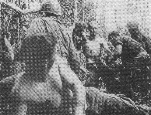 Wounded American soldiers being moved to aid station (Battle of Dak To, 1967)