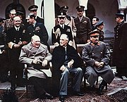 Winston Churchill at the Yalta Conference, with Roosevelt and Stalin beside him.