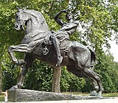 outdoor statue of a horse with a naked male rider