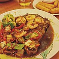 •Seared Ribeye and Garlic Shrimp• Applebee's 12 oz Ribeye steak cooked medium well and topped with Garlic Shrimps and sautéed vegetables.jpg
