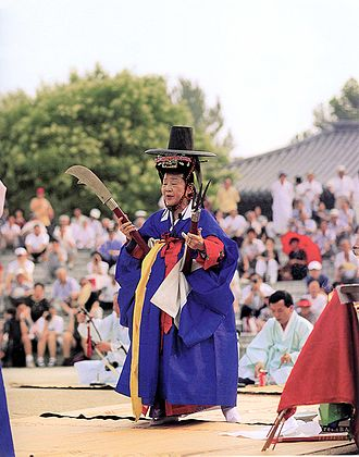 Korean shamanism - A mudang performing a gut in Seoul, South Korea.