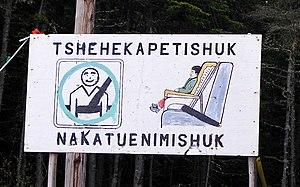 "Innu - ""Buckle up your children"" sign in Innu-aimun language, in the Pointe-Parent reserve near Natasquan, Quebec."