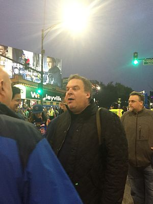 Jeff Garlin - Garlin is an avid fan of the Chicago Cubs. In this image, he is seen in Wrigleyville before Game Four of the 2016 World Series.