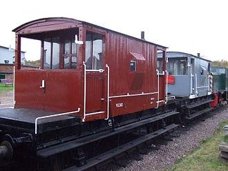 Grab bar - Horizontal and vertical grab bars (white) on the sides of British railroad brake vans.