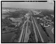 AERIAL VIEW LOOKING SOUTH TARRANT COKE WORKS IN BACKGROUND (TOP LEFT). - Birmingham Southern Railroad Yard, Thirty-fourth Street, Ensley, Jefferson County, AL HAER ALA,37-ENS,1-3.tif