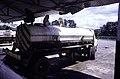 ASC Leiden - F. van der Kraaij Collection - 13 - 020 - The Firestone rubber plantation. A latex tank truck with a man sitting on top delivering liquid latex - Harbel, Montserrado county, Liberia - 1976.jpg