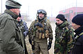 A Norwegian soldier, center, meets with civilian role players acting as leaders of a simulated Afghan town during a military adviser team (MAT) and police adviser team (PAT) training exercise at the Hohenfels 131212-A-LO967-006.jpg