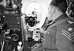 A ground crew sergeant demonstrates the operation of the photo-reconnaissance camera in a de Havilland Mosquito of No. 540 Squadron RAF at Benson, Oxfordshire, August 1943. CH10853.jpg