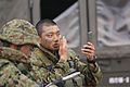 A member of the Japanese Ground Self-Defense Force, right, puts camouflage on before his unit starts a patrolling exercise at Marine Corps Base Camp Pendleton, Calif., June 12, 2013, during exercise Dawn Blitz 130612-M-JU912-045.jpg