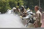 A member of the Marine Corps Air Station Beaufort fire department is washed as he goes through a decontamination center at the sight chemical spill at the training pool atMarine Corps Air Station Beaufort, South 130719-M-VR358-088.jpg