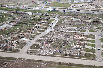 2013 Moore tornado - Aerial view of a destroyed neighborhood to east of Interstate 35, taken by the Oklahoma National Guard.