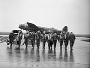 Aircrew of No. 106 Squadron photographed in front of a Lancaster at Syerston, Nottinghamshire, on the morning after the raids on Genoa, 22-23 October 1942. CH17504