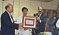 Ajit Singh releasing a Commemorative Special Cover, designed by Department of Posts to mark the Silver Jubilee of the Bureau of Civil Aviation Security (BCAS), in New Delhi. The Civil Aviation Secretary.jpg