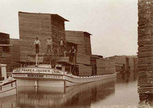 Lumber yard - Frank A. Jagger loads his boat full of lumber at the Albany Lumber District in Albany, New York in the 1870s