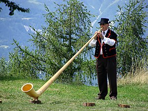 Alphorn - A Swiss playing alphorn
