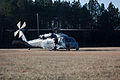 An MH-60 Seahawk helicopter with the Helicopter Sea Combat Squadron 22 (HSC-22), waits to pick up Canadian soldiers with the 37th Canadian Brigade Group at Fort Pickett, Va., March 4, 2013, during Exercise 130304-A-KH856-073.jpg