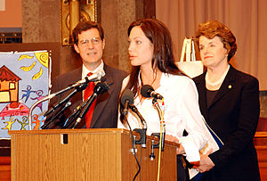 Sam Brownback - Senators Brownback and Feinstein in 2003 joined with Angelina Jolie, the Goodwill Ambassador for United Nations High Commissioner for Refugees, call on bipartisan legislation to reform the treatment of unaccompanied alien minors