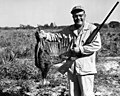 Art Mercier posing with his turkey in Palmdale (38415426966).jpg