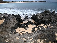 Image of black igneous rocks on the coast of Ascension Island