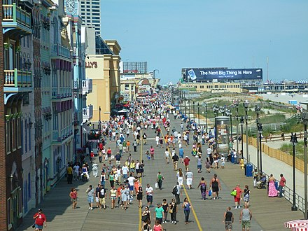 Atlantic City Boardwalk view from Ceasers Atlantic City. Opened in 1870, it was the first boardwalk built in the United States. At 5.5 miles long, it is also the longest in the world. Atlantic City Boardwalk view north from Caesars Atlantic City by Silveira Neto June 24 2012.jpg