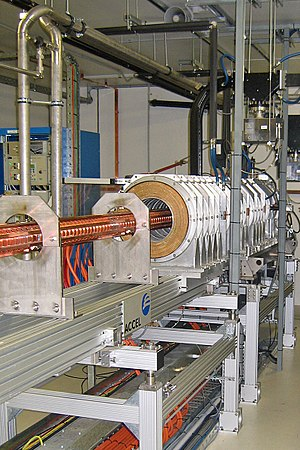 Linear particle accelerator - The linac within the Australian Synchrotron uses radio waves from a series of RF cavities at the start of the linac to accelerate the electron beam in bunches to energies of 100 MeV.