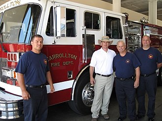 Austin Scott (politician) - Austin Scott meets with members of the Carrollton, GA fire department on July 20, 2009 during the Walk of Georgia.