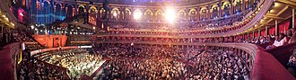 The Proms - A panorama of the 2015 season of The Proms, with the seats behind the orchestra half-and-half with choral members and audience.