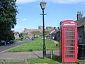 Bamburgh telephone box, with castle in background - geograph.org.uk - 950415.jpg